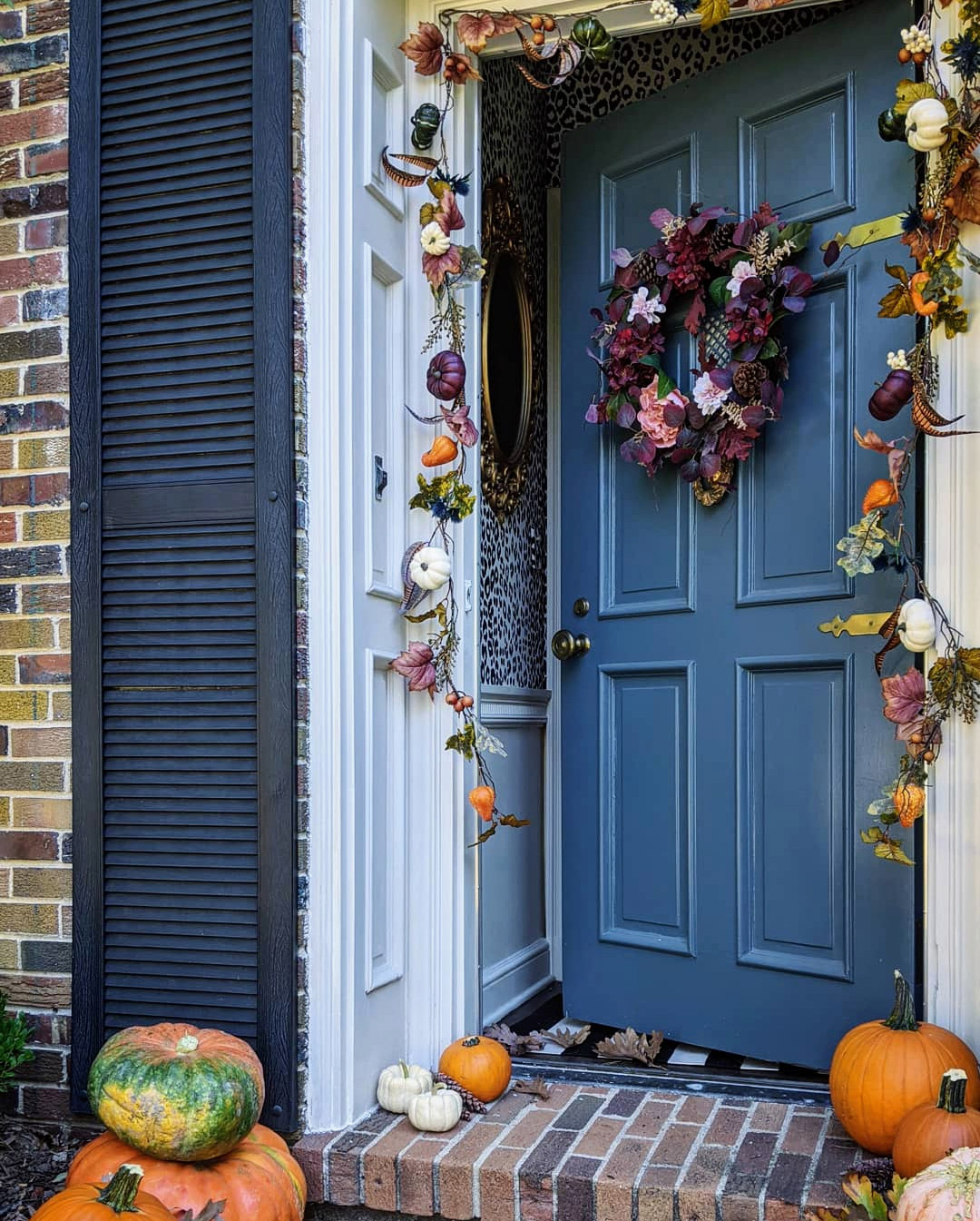 fall porch colorful door garland pumpkins and gourds