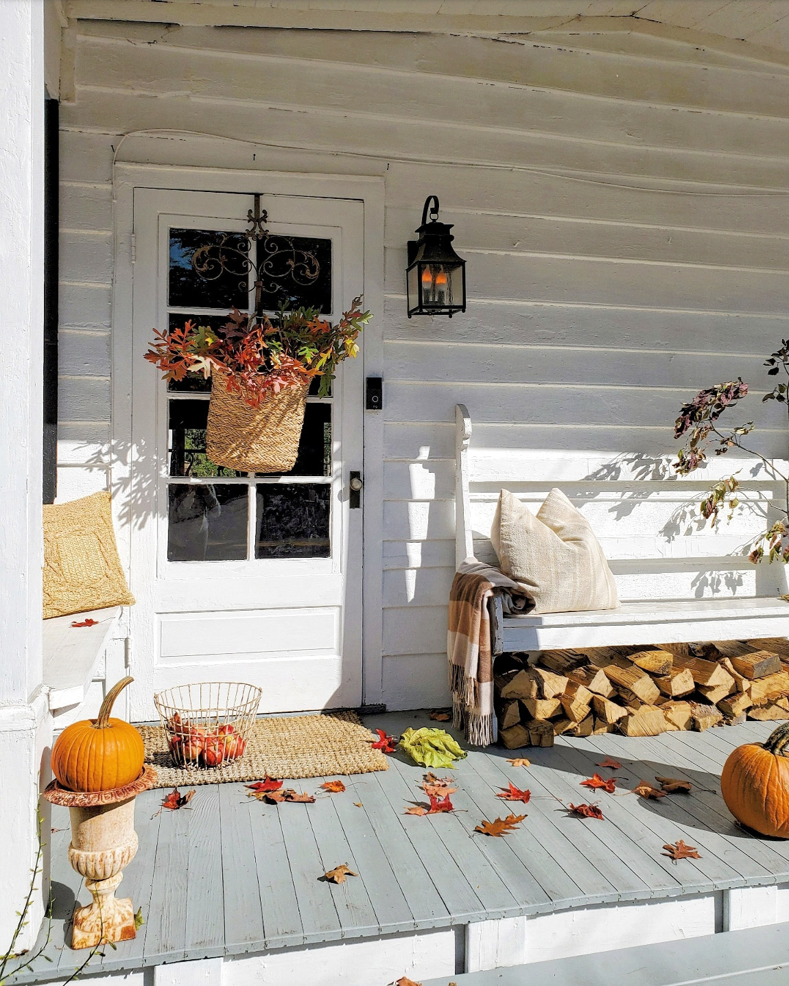 fall porch with colorful leaves in baskets