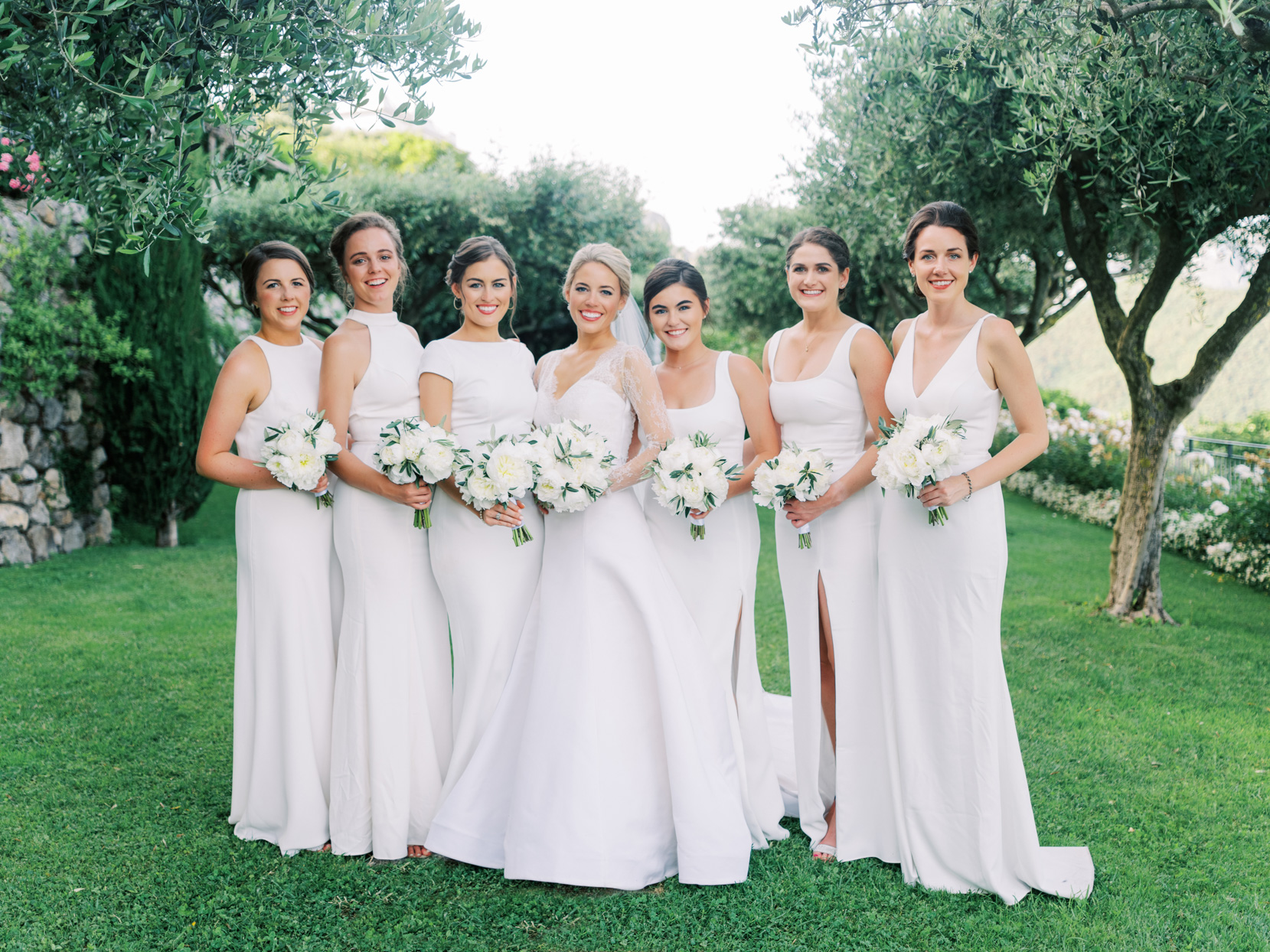 bride and bridesmaids in white dresses