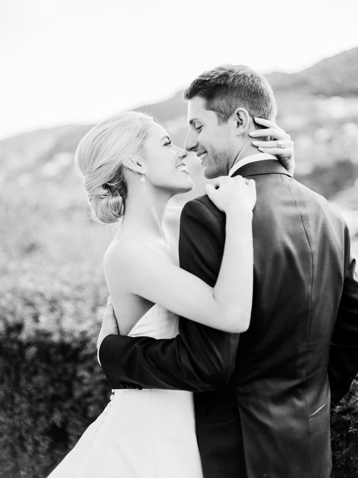 wedding couple smiling at each other during portrait