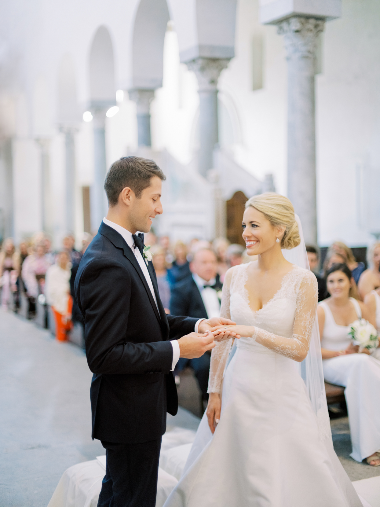 wedding couple exchanging rings in church