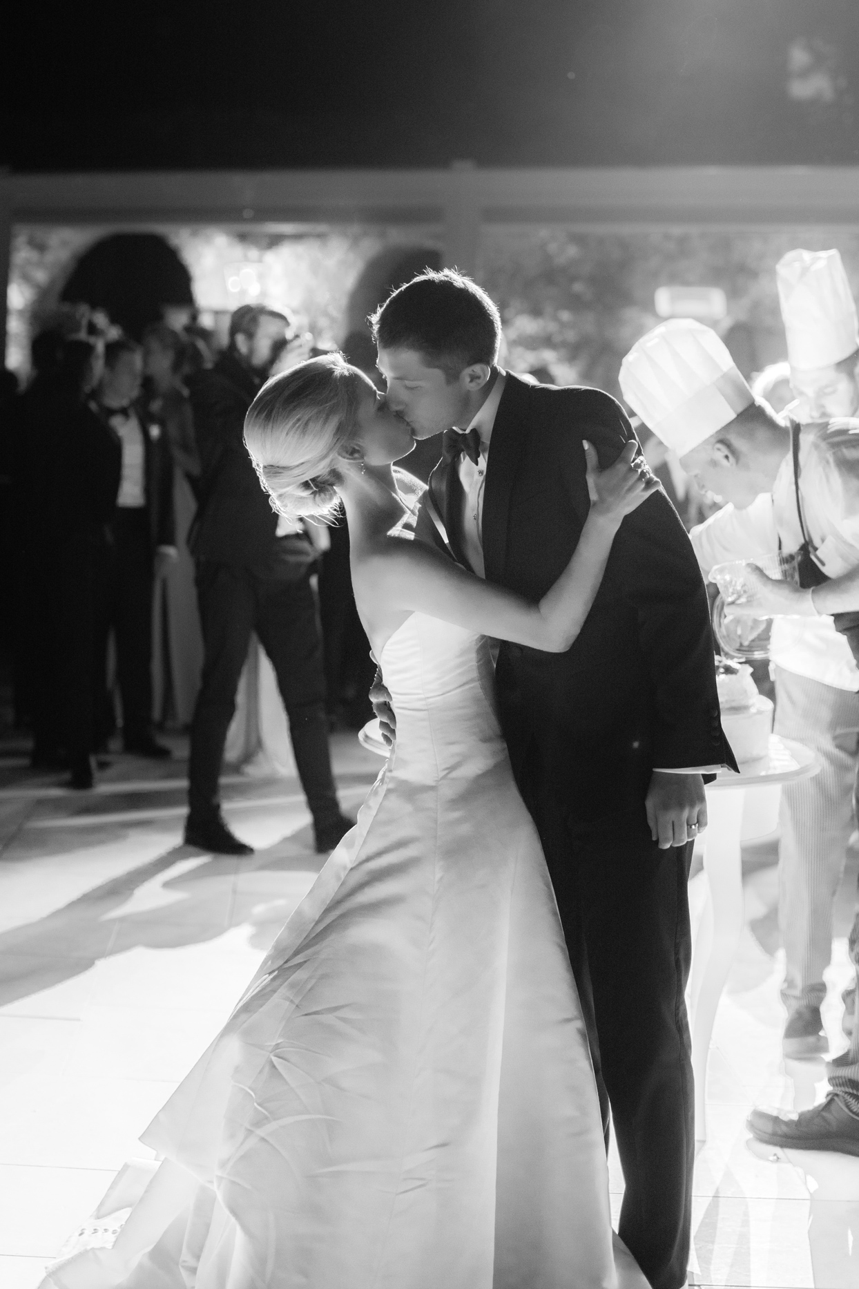 wedding couple kissing during first dance