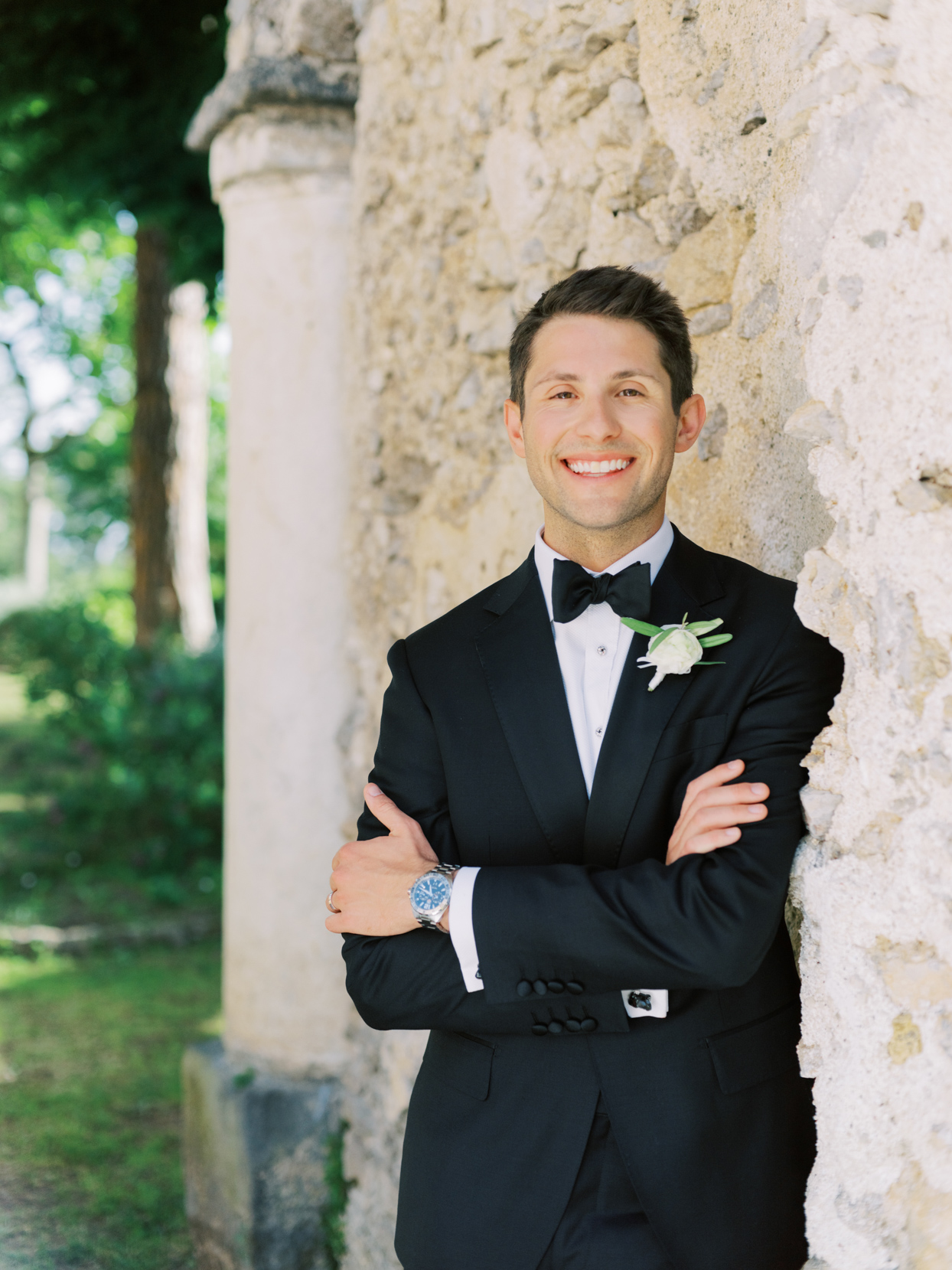 groom in black tux and bowtie