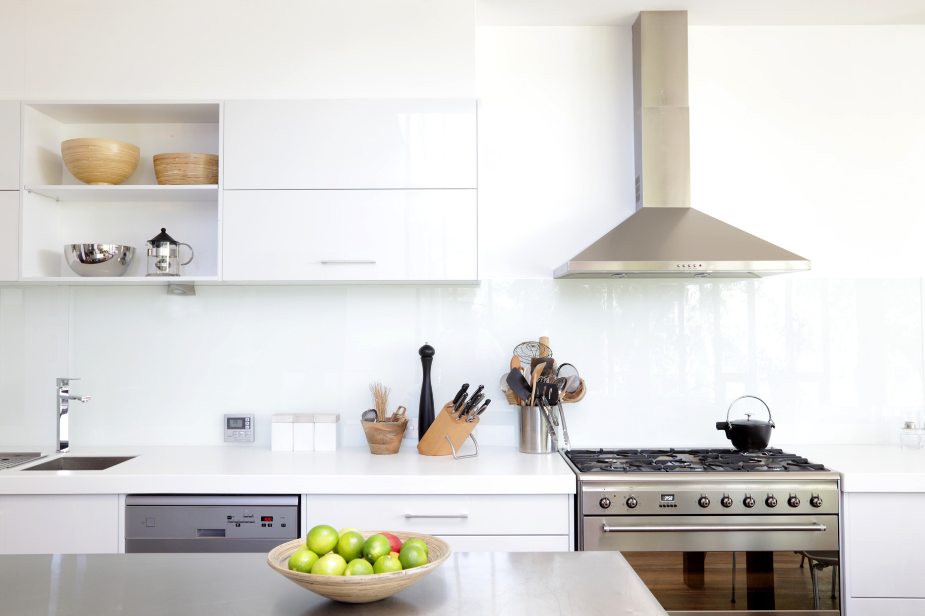 white kitchen with stainless steel appliances