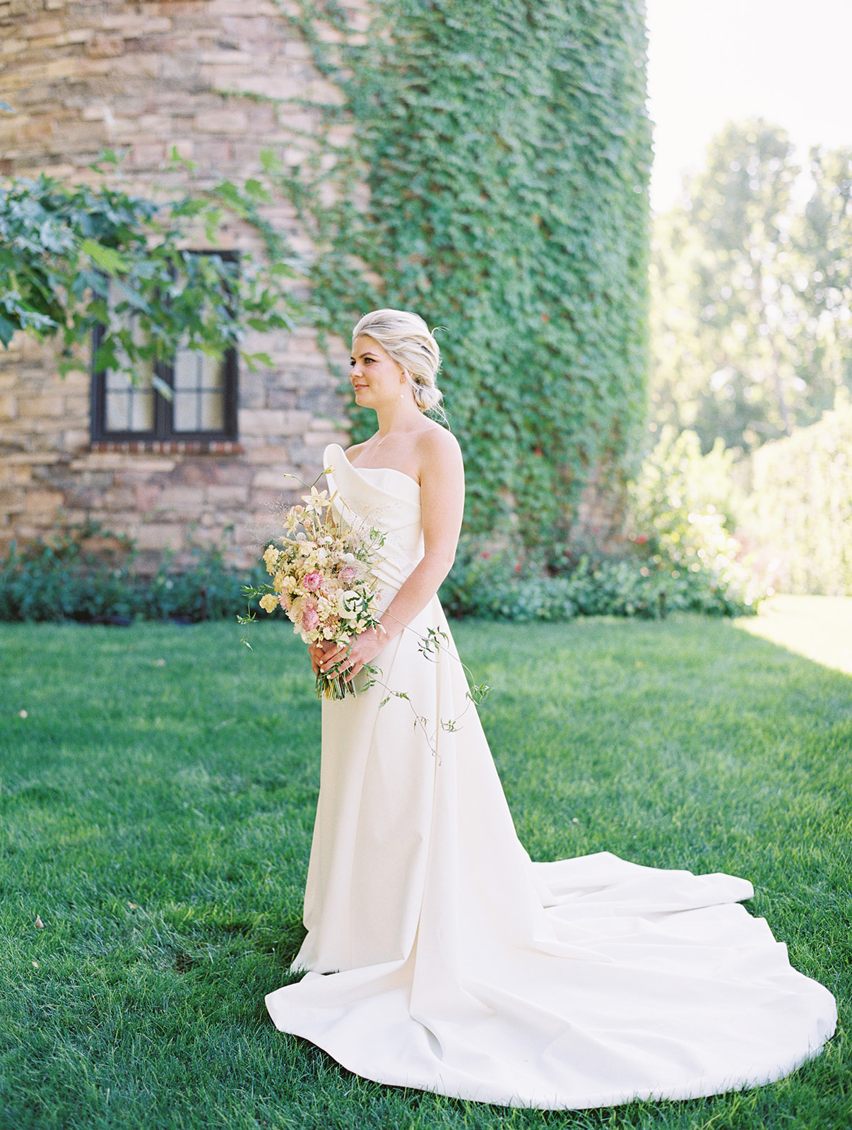 bride wearing an off-white architectural dress