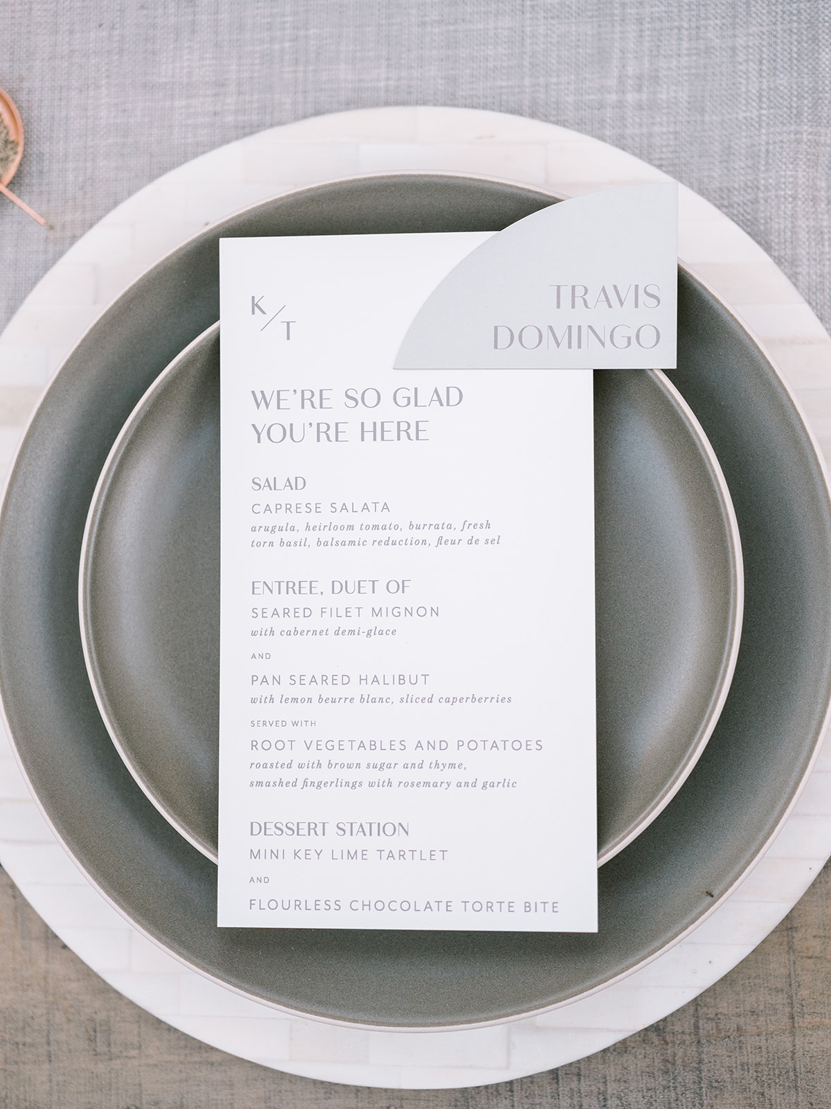 white and gray place setting with menu