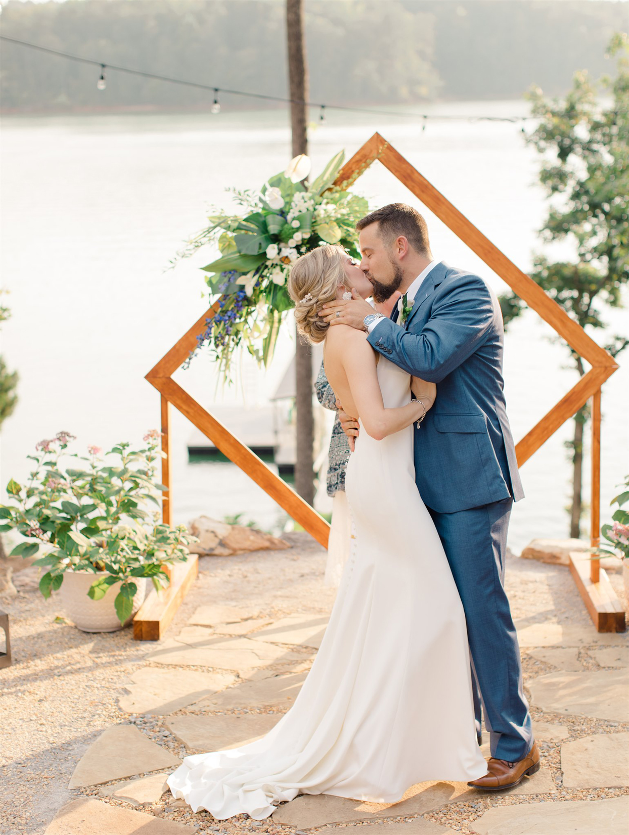 bride and groom sharing wedding ceremony kiss