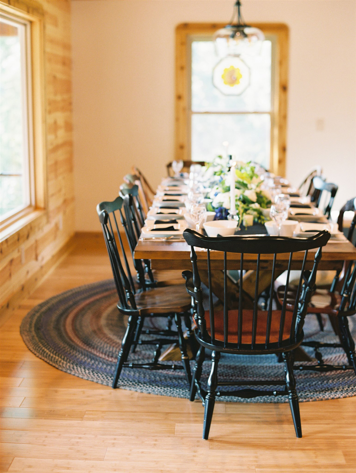 intimate wedding reception table in lakefront cabin