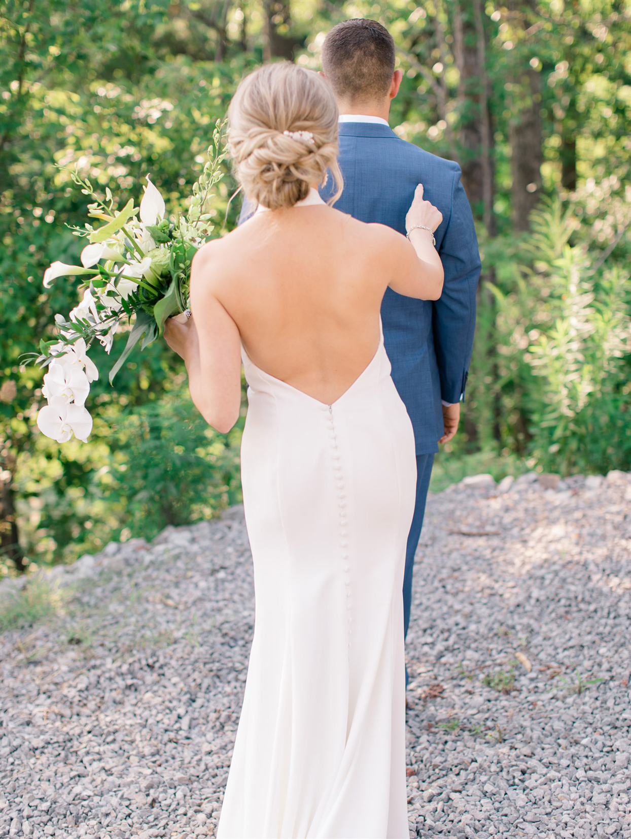 bride tapping on grooms back for first look