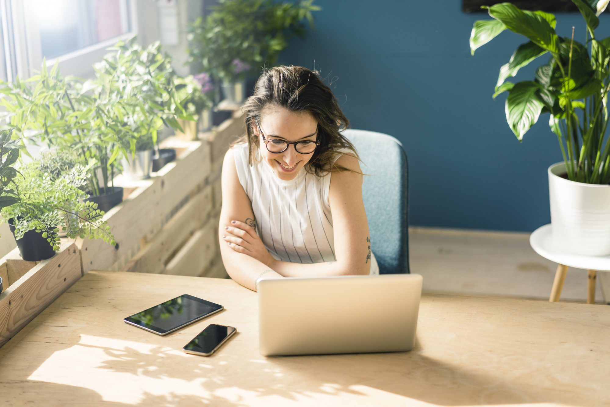 woman working at her desk on a laptop