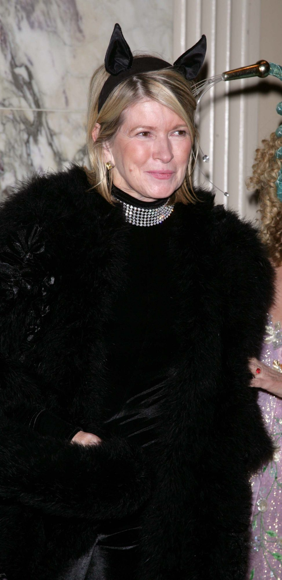 "Martha as a black cat at Bette Midler's New York Restoration Project's ""Hulaween"" Gala"