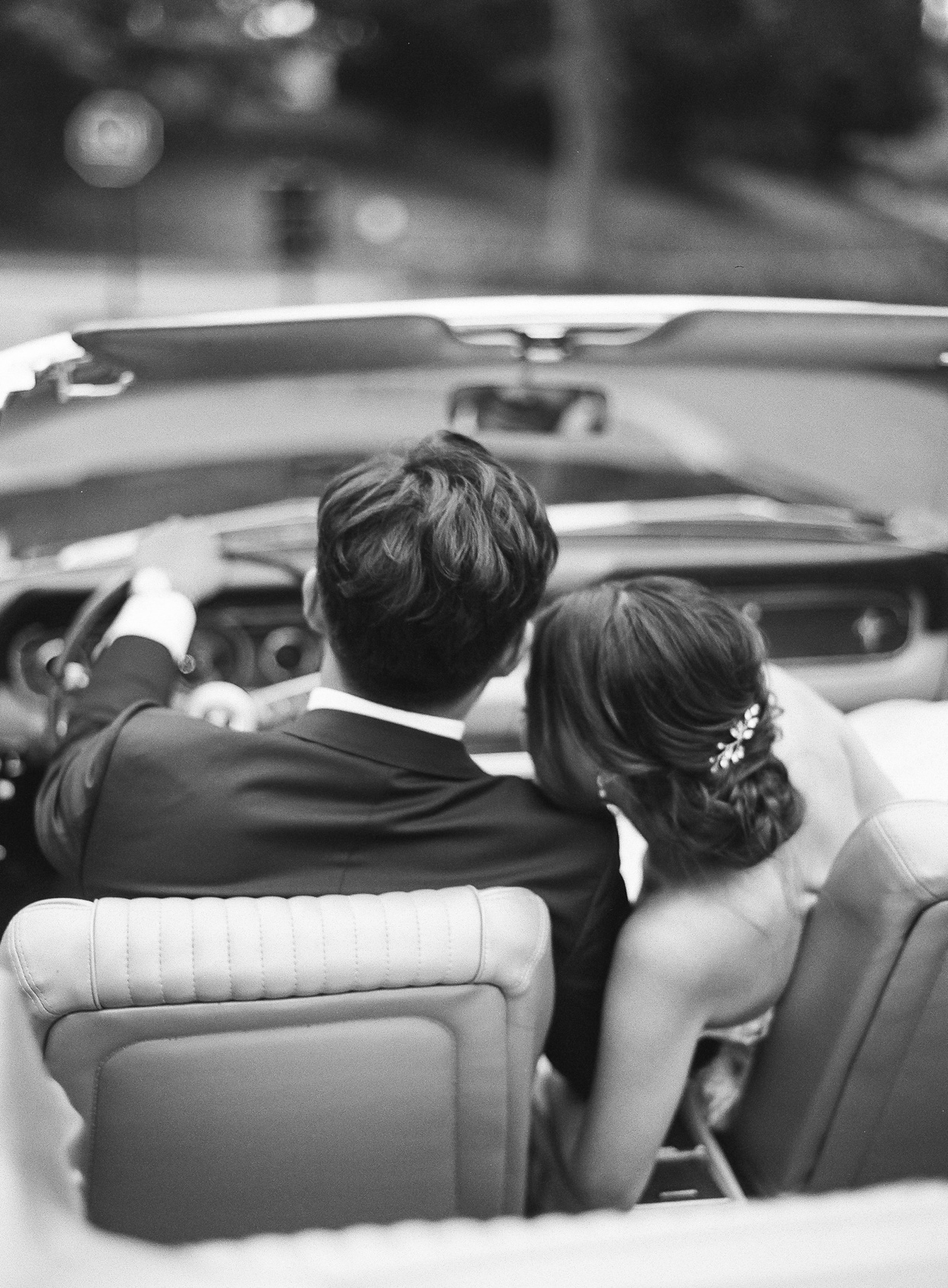 couple riding together in vintage car