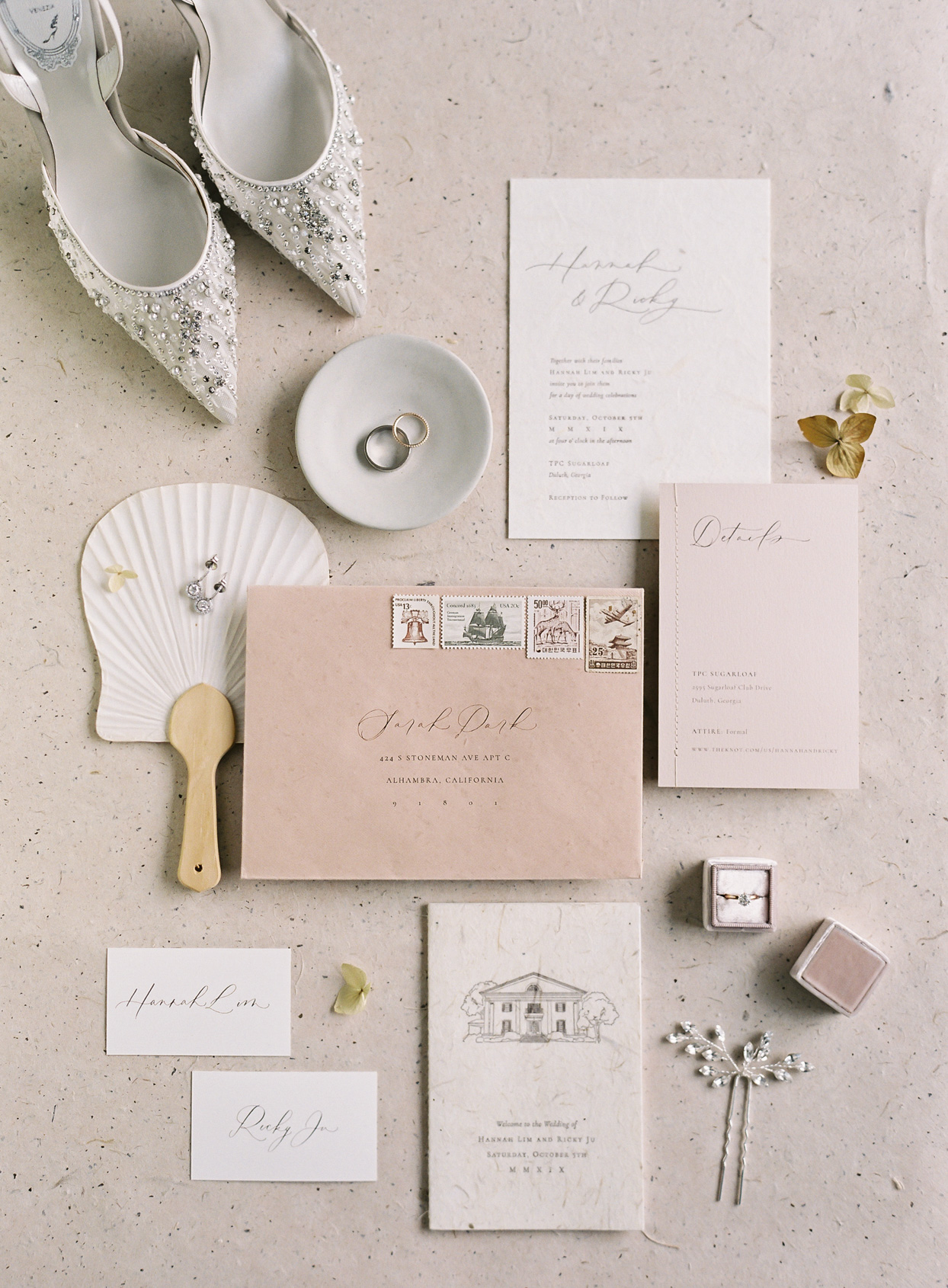 elegant dusty rose wedding stationary and accessories