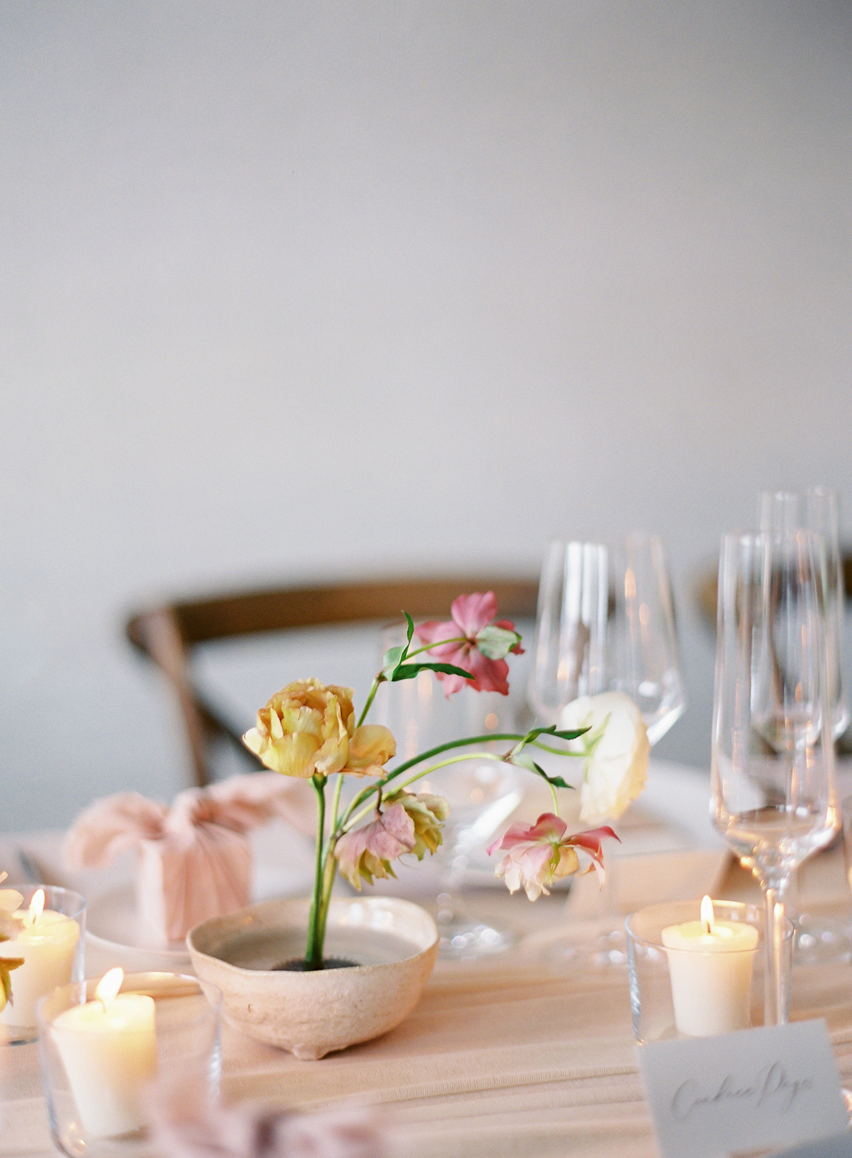 blush floral reception centerpiece on table