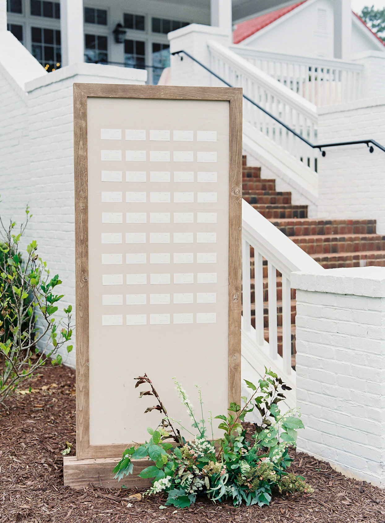 simple dusty rose seating chart sign with wood frame