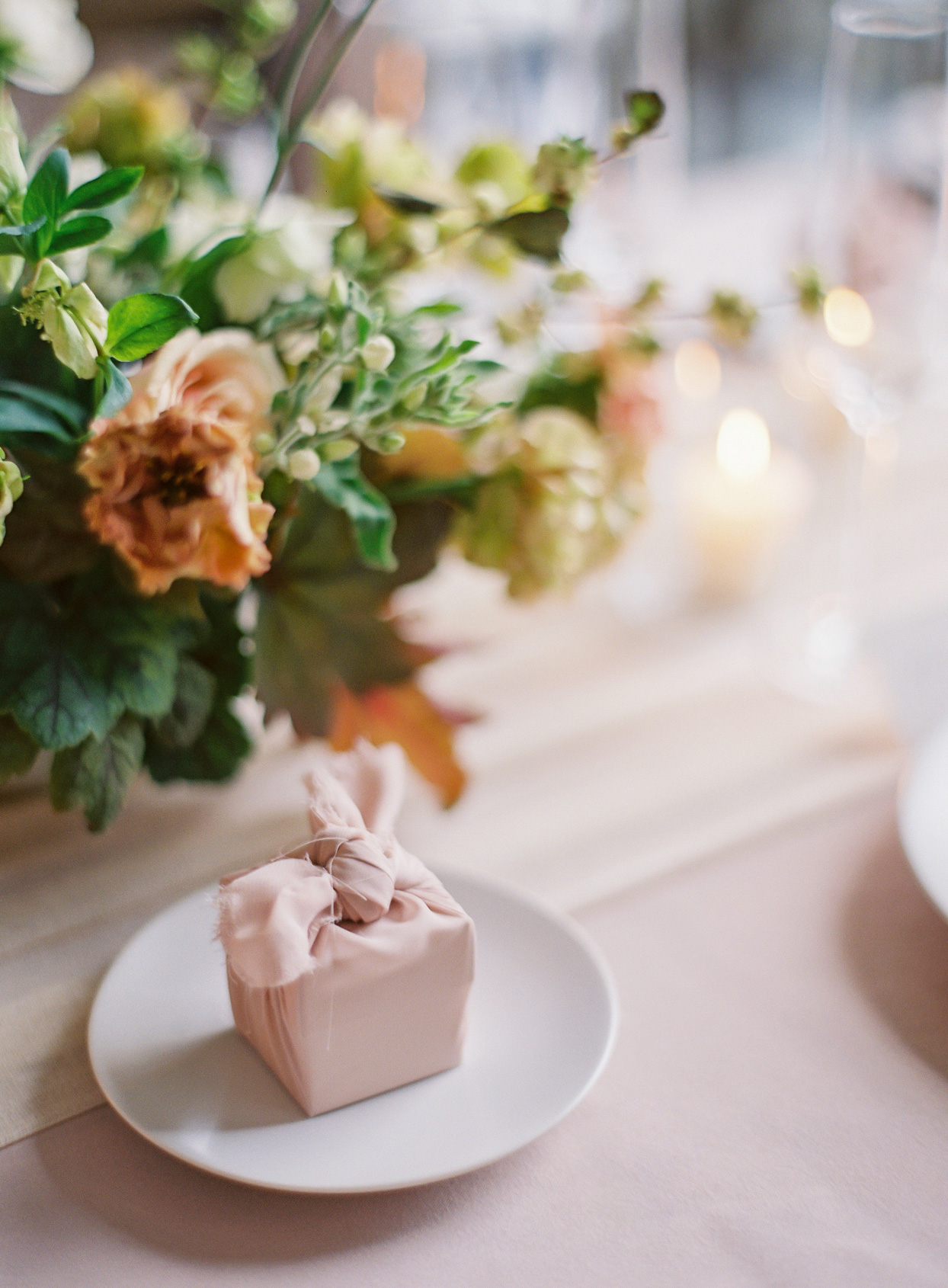 dusty rose wrapped square box with flowers