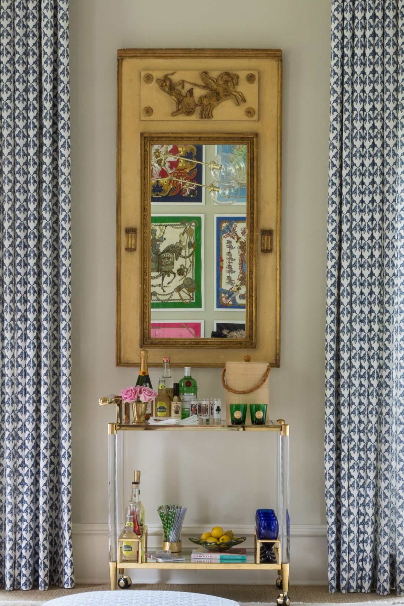 antique bar cart and mirror by curtains