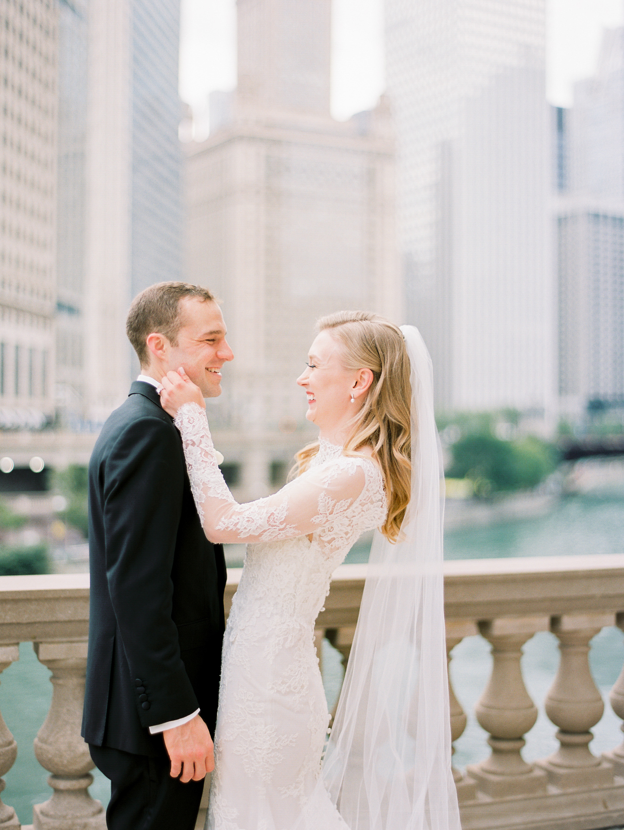 wedding couple smiling above chicago river