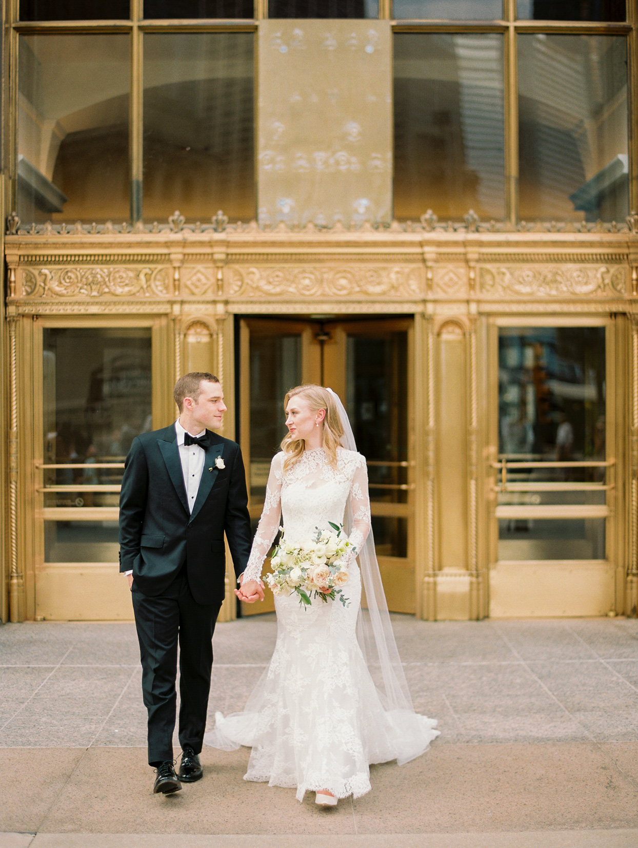 couple portrait in front of gold chicago building