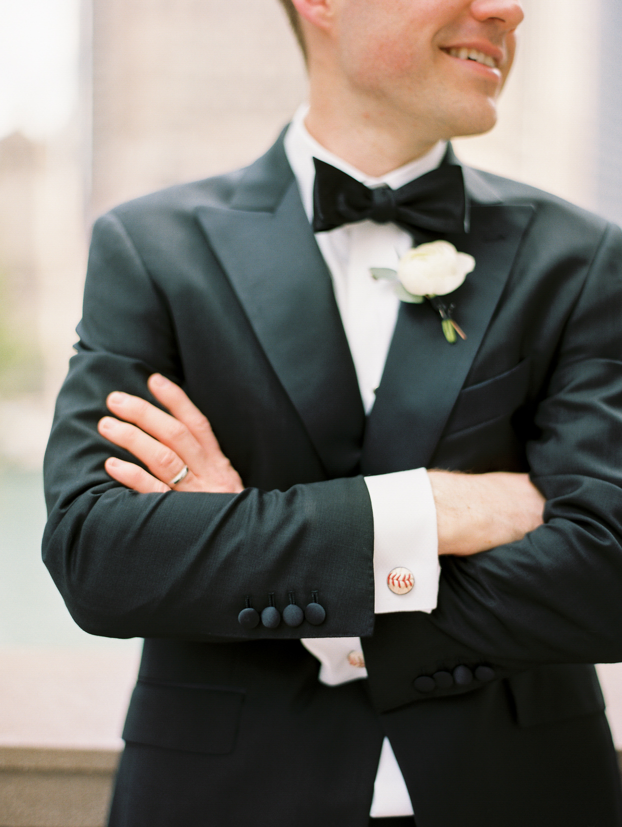 groom in black and white with customized cuff links