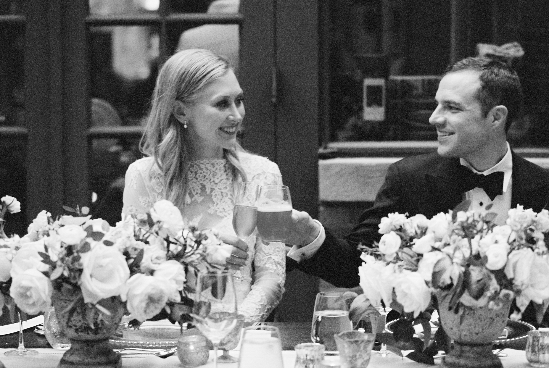 bride and groom toasting during reception