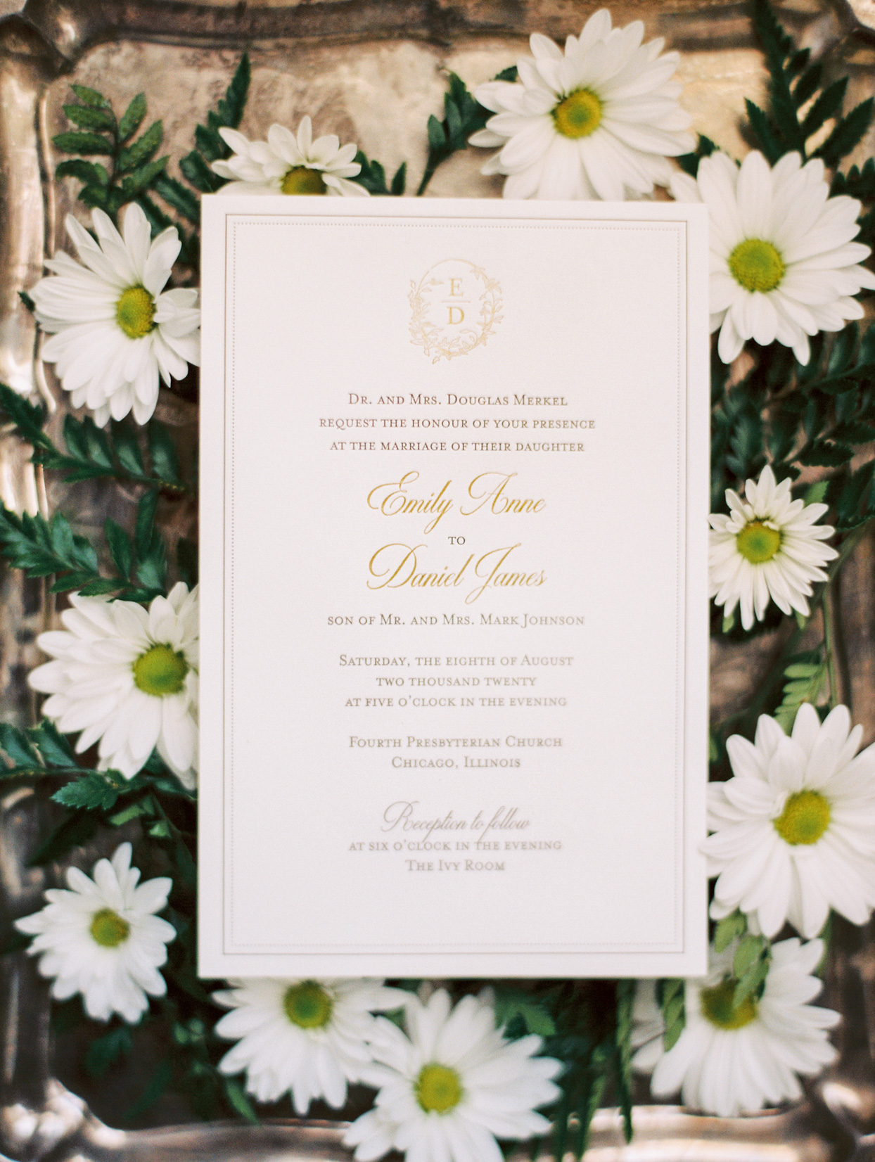 simple elegant wedding invitations surrounded by white flowers