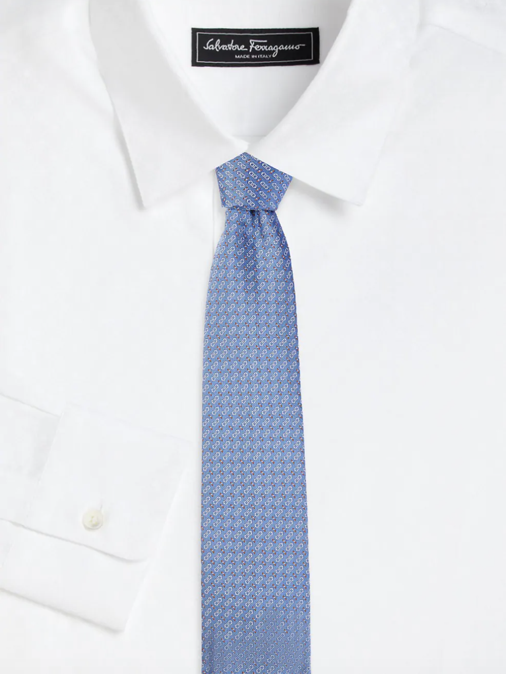 blue patterned silk tie on white collared shirt