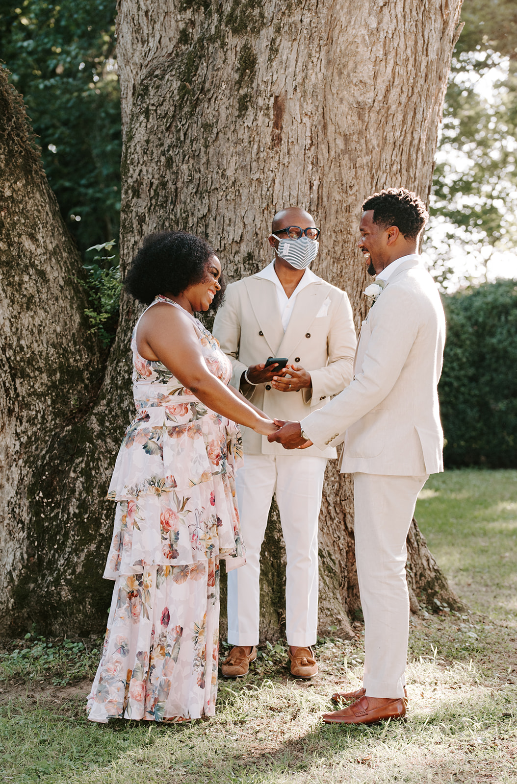 chelsea jordaan wedding couple holding hands during the ceremony