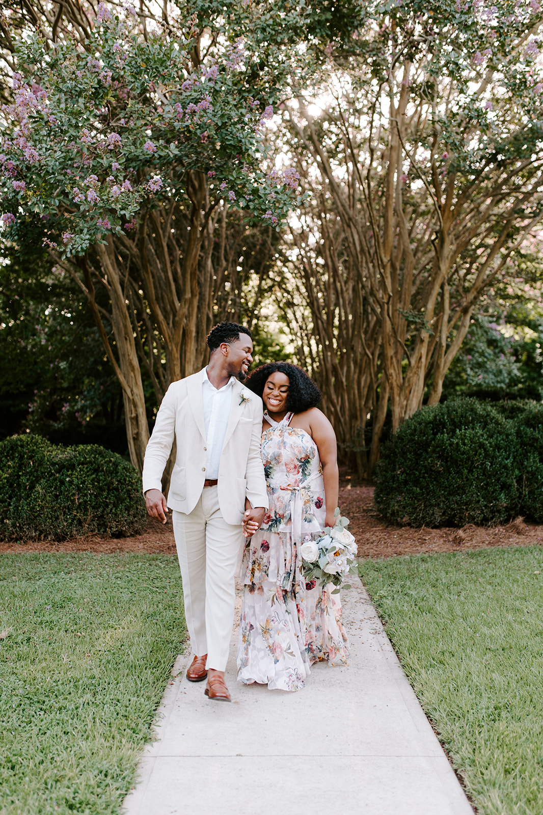 chelsea jordaan wedding couple holding hands while walking and smiling