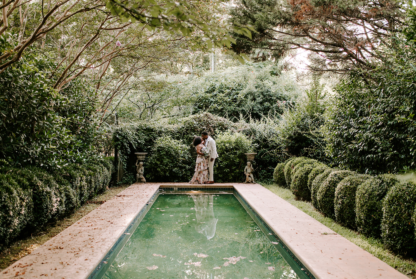 chelsea jordaan wedding couple kissing surrounded by greenery at their venue