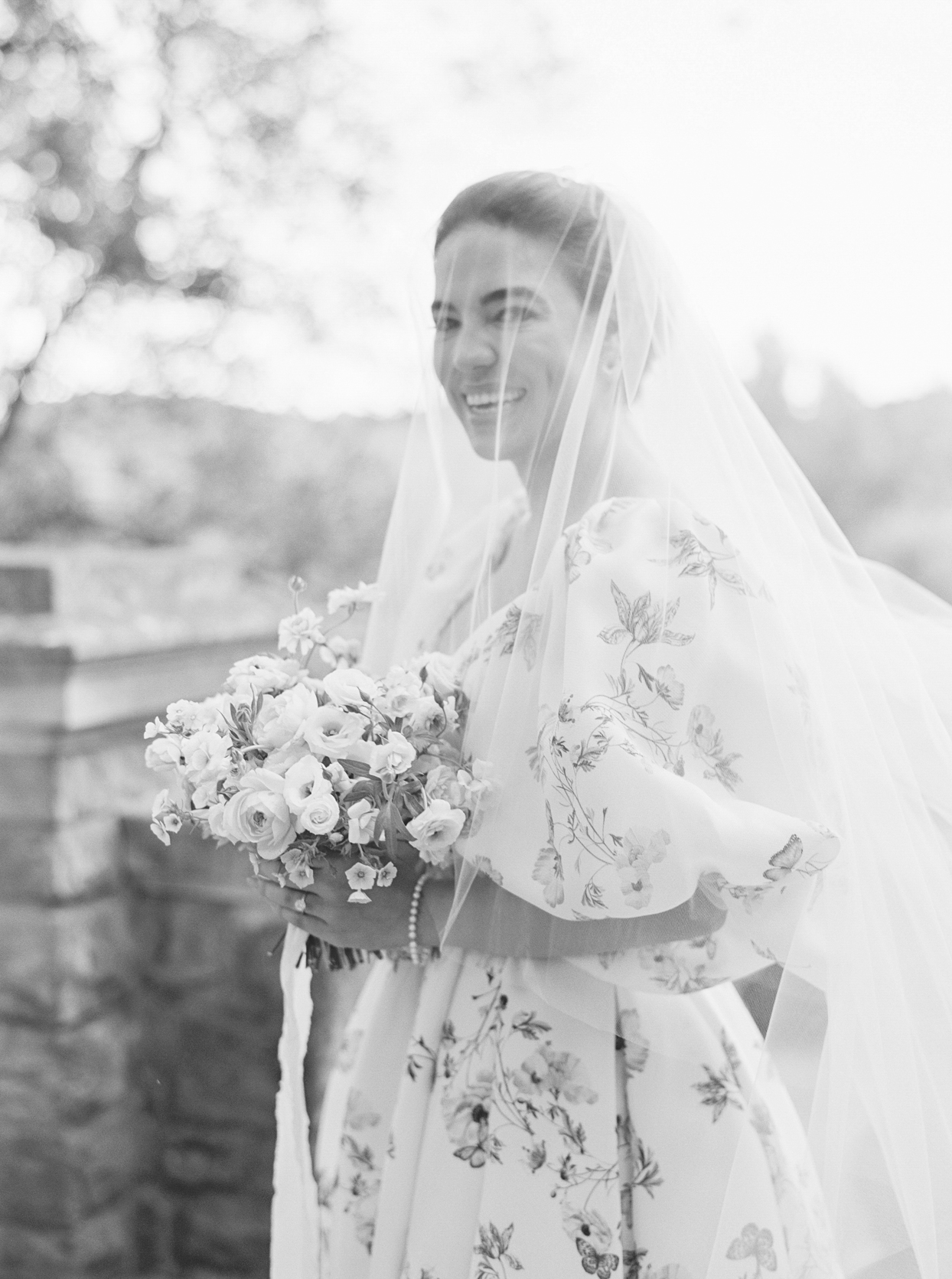 bride in floral wedding dress and veil