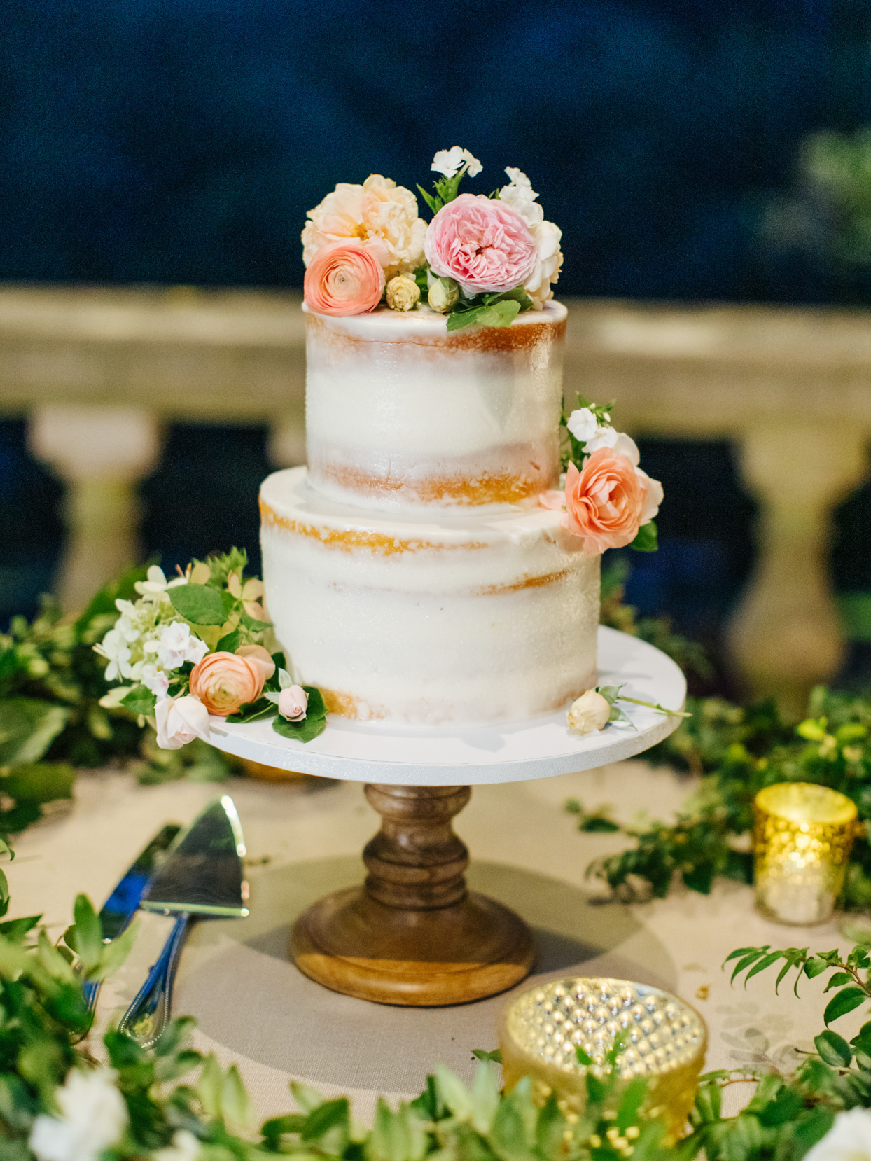 naked wedding cake with peach and pink flowers