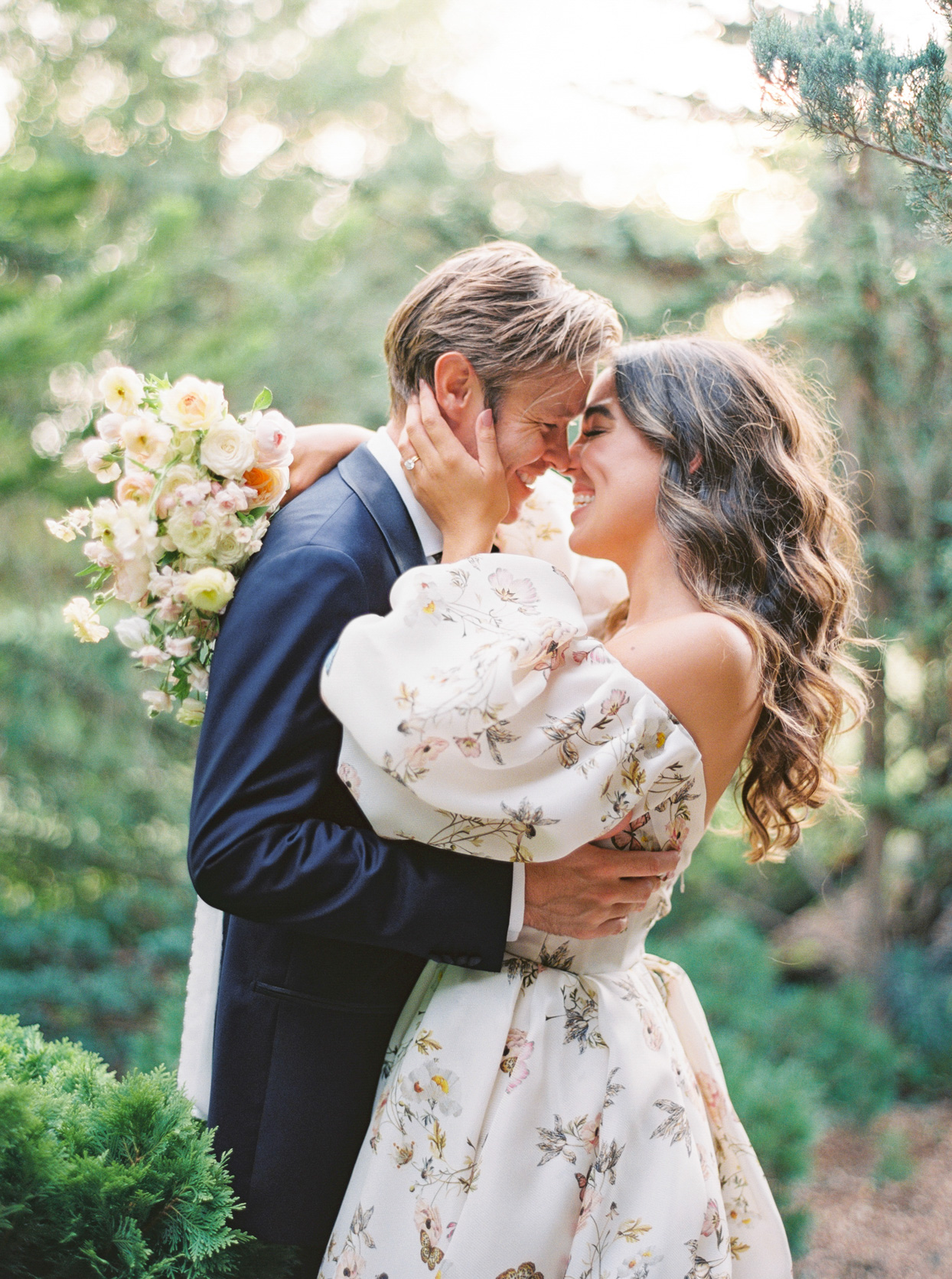 bride and groom embracing for wedding portrait