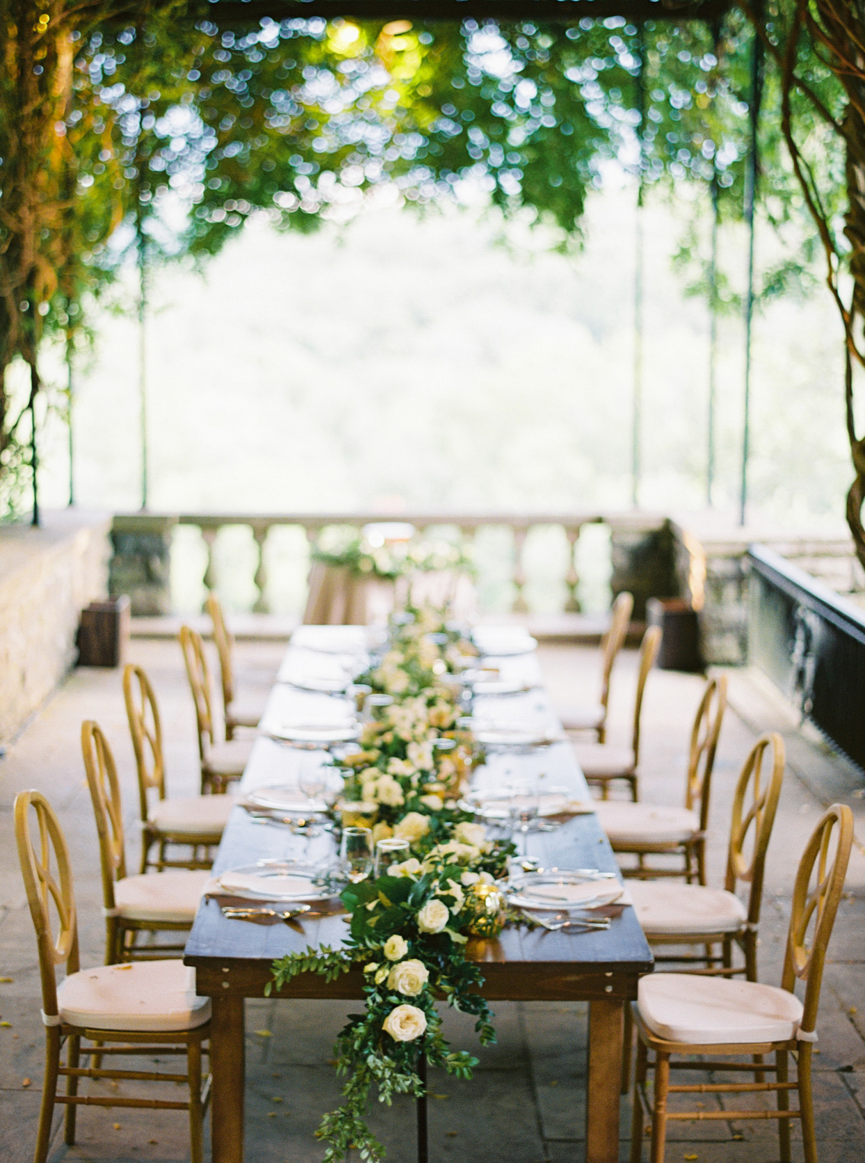 wedding reception dinner table with garland and flowers