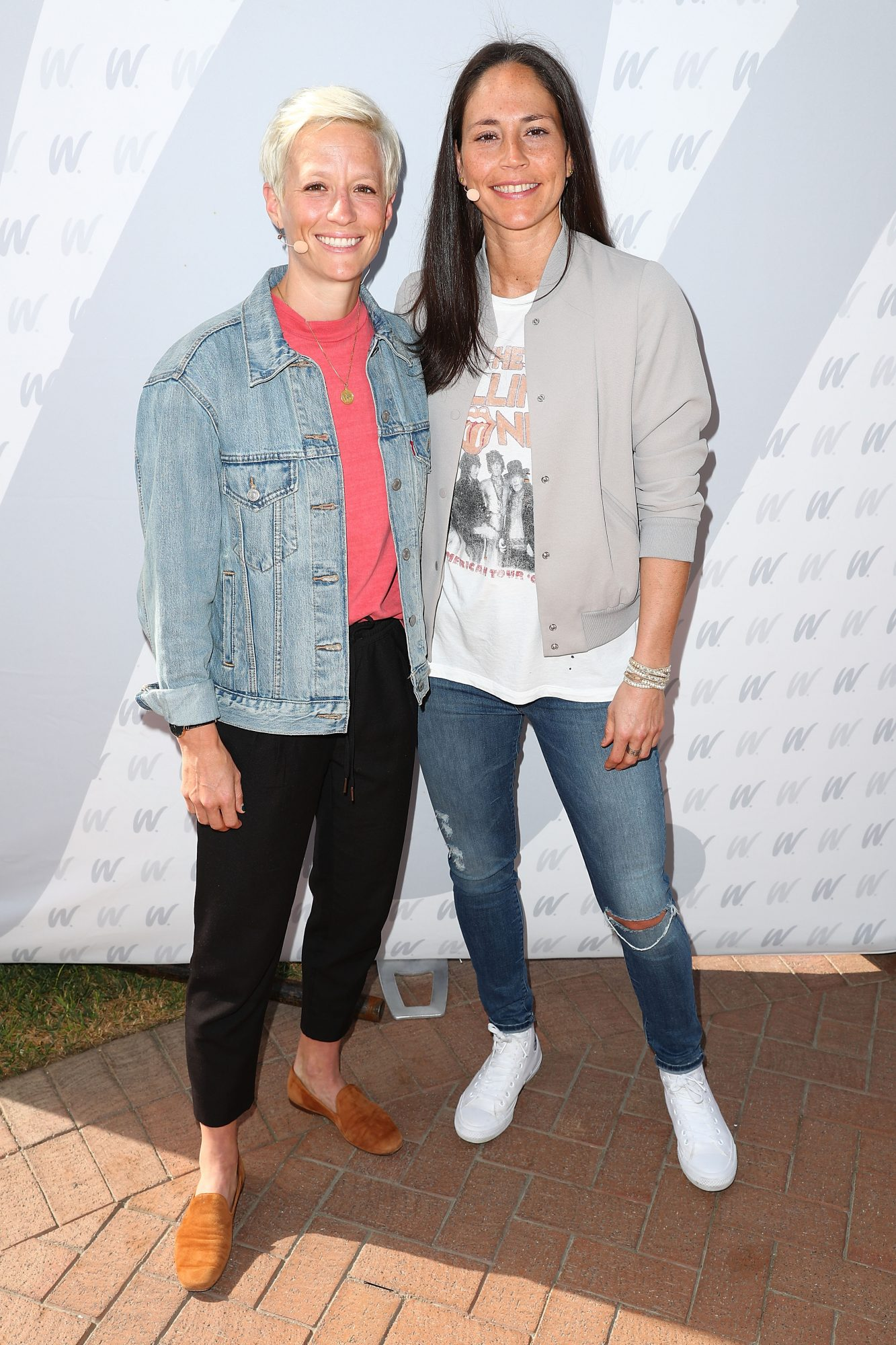 Megan Rapinoe and Sue Bird posing together on the 8th Annual espnW: Women + Sports Summit event red carpet