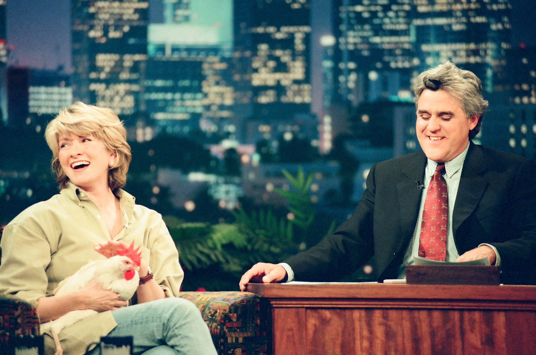 Martha Stewart holding a chicken on Jay Leno