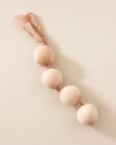 wool dryer balls dropped into nylon stockings with knots