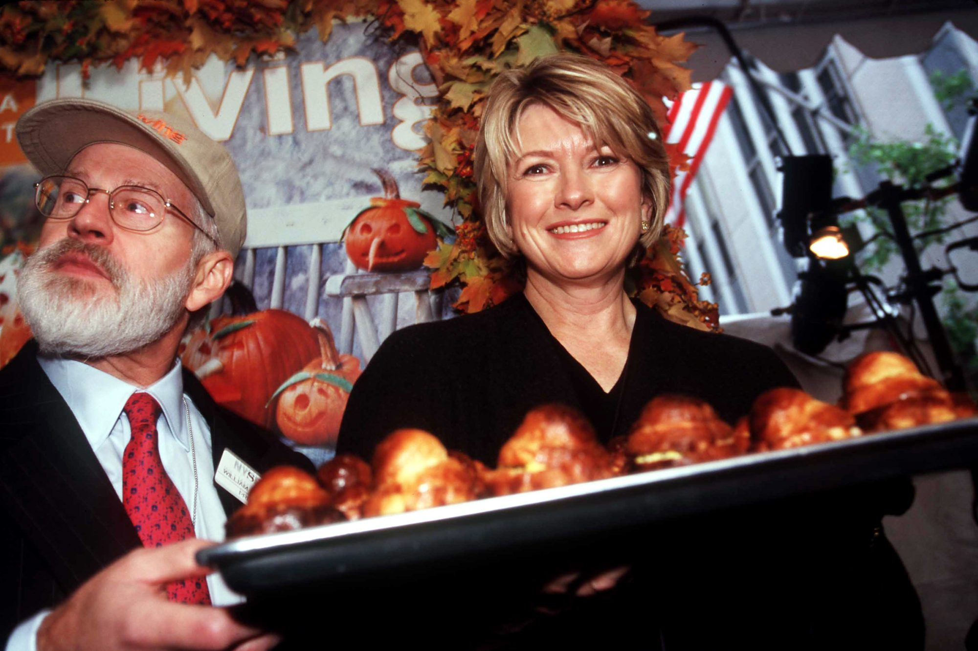 martha stewart at new york stock exchange holding pastries