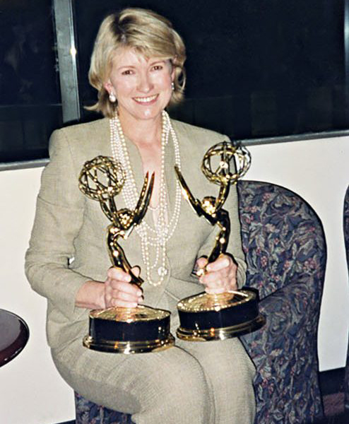 martha holding emmy awards
