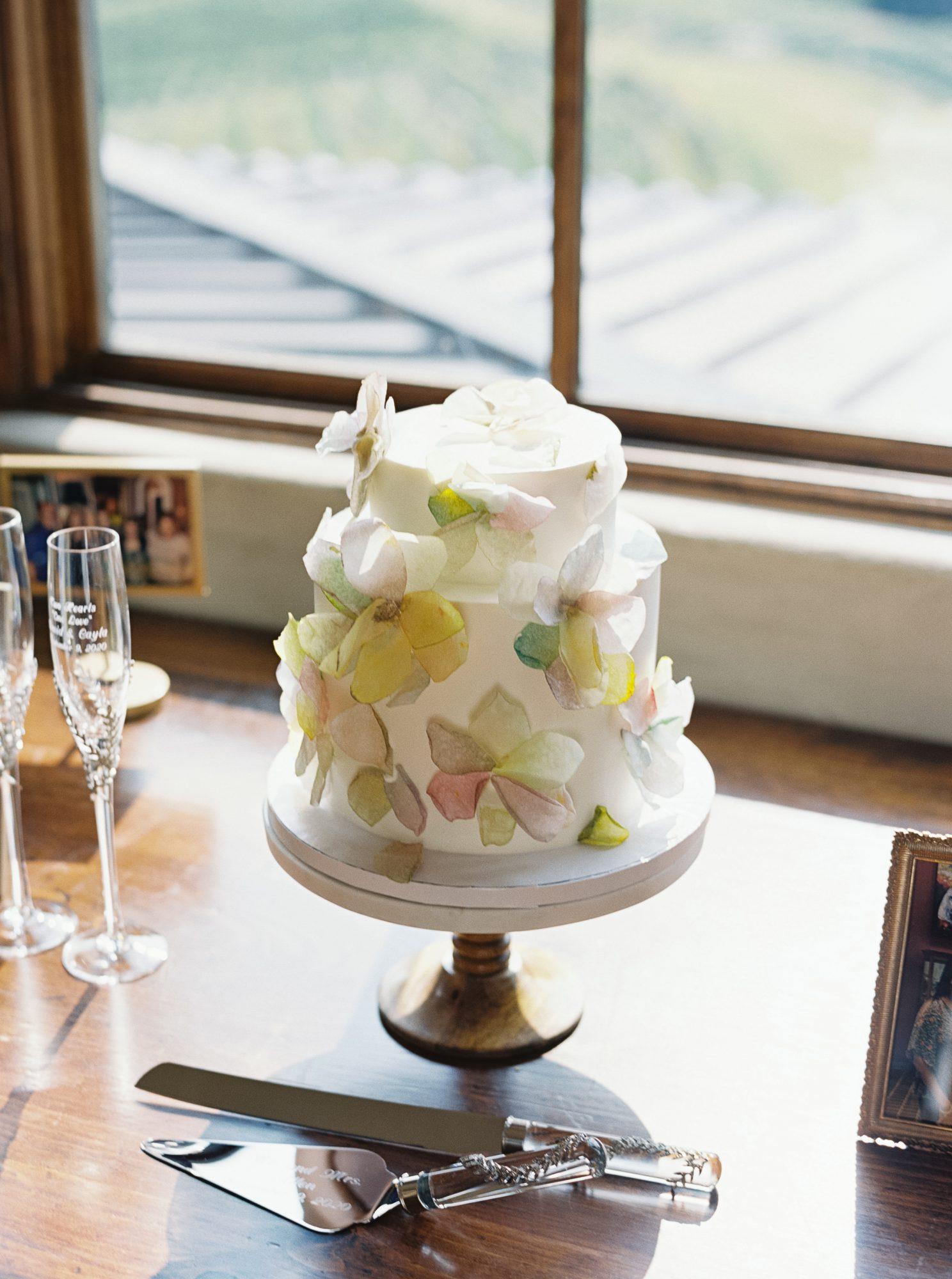 cayla david wedding cake with floral accents