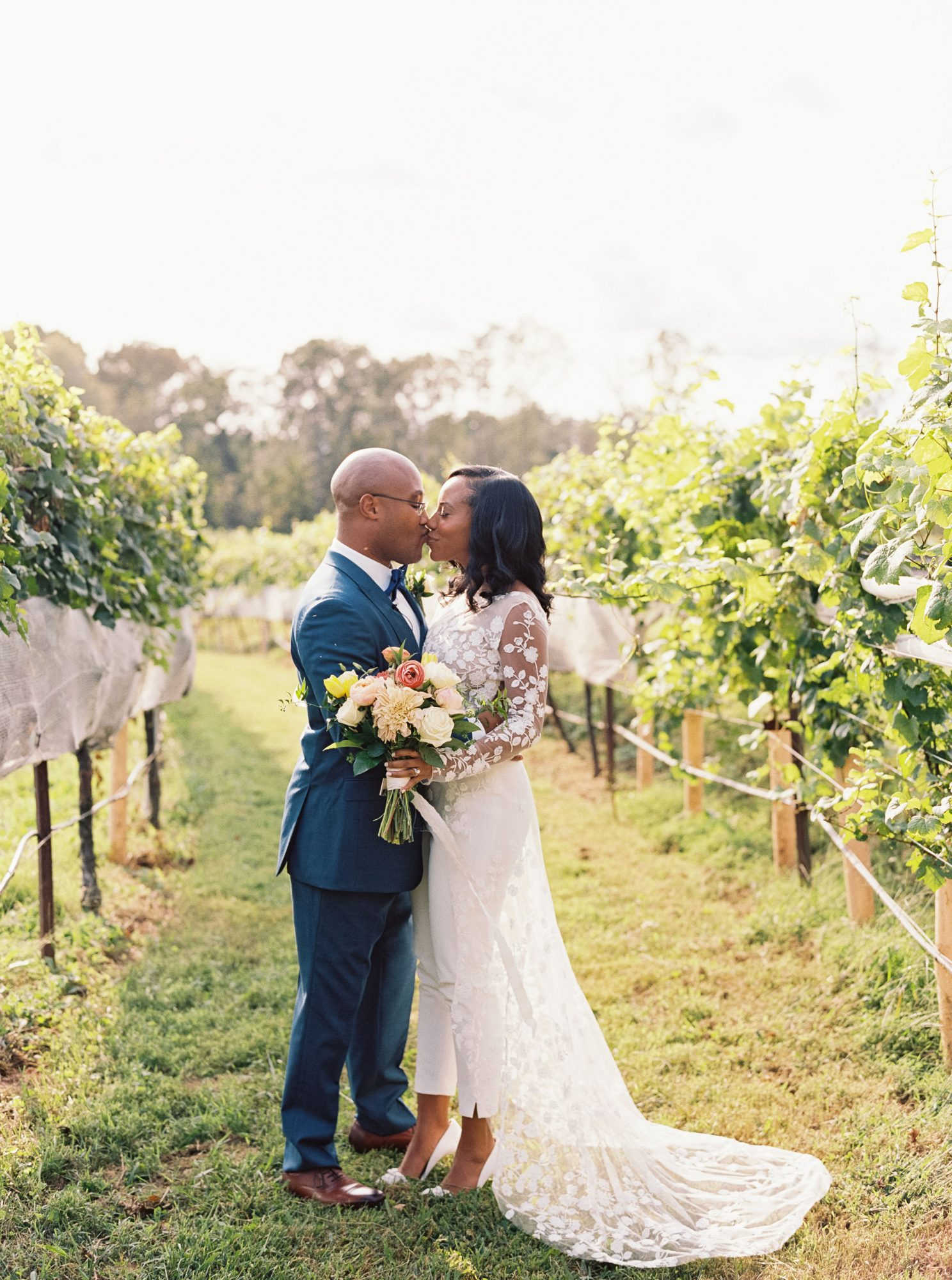 cayla david wedding couple kiss in vineyard