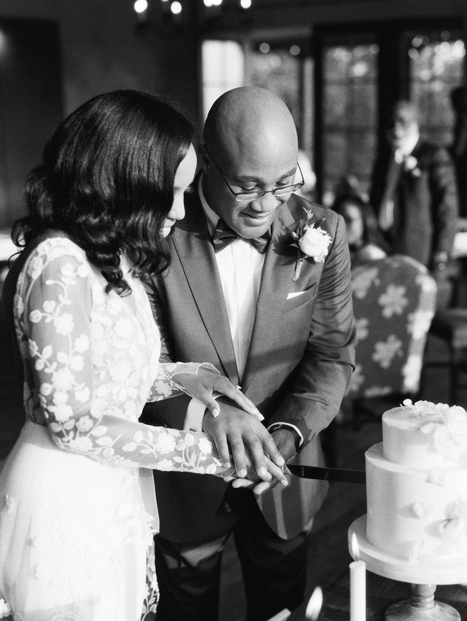 cayla david wedding couple holding hands while cutting their cake