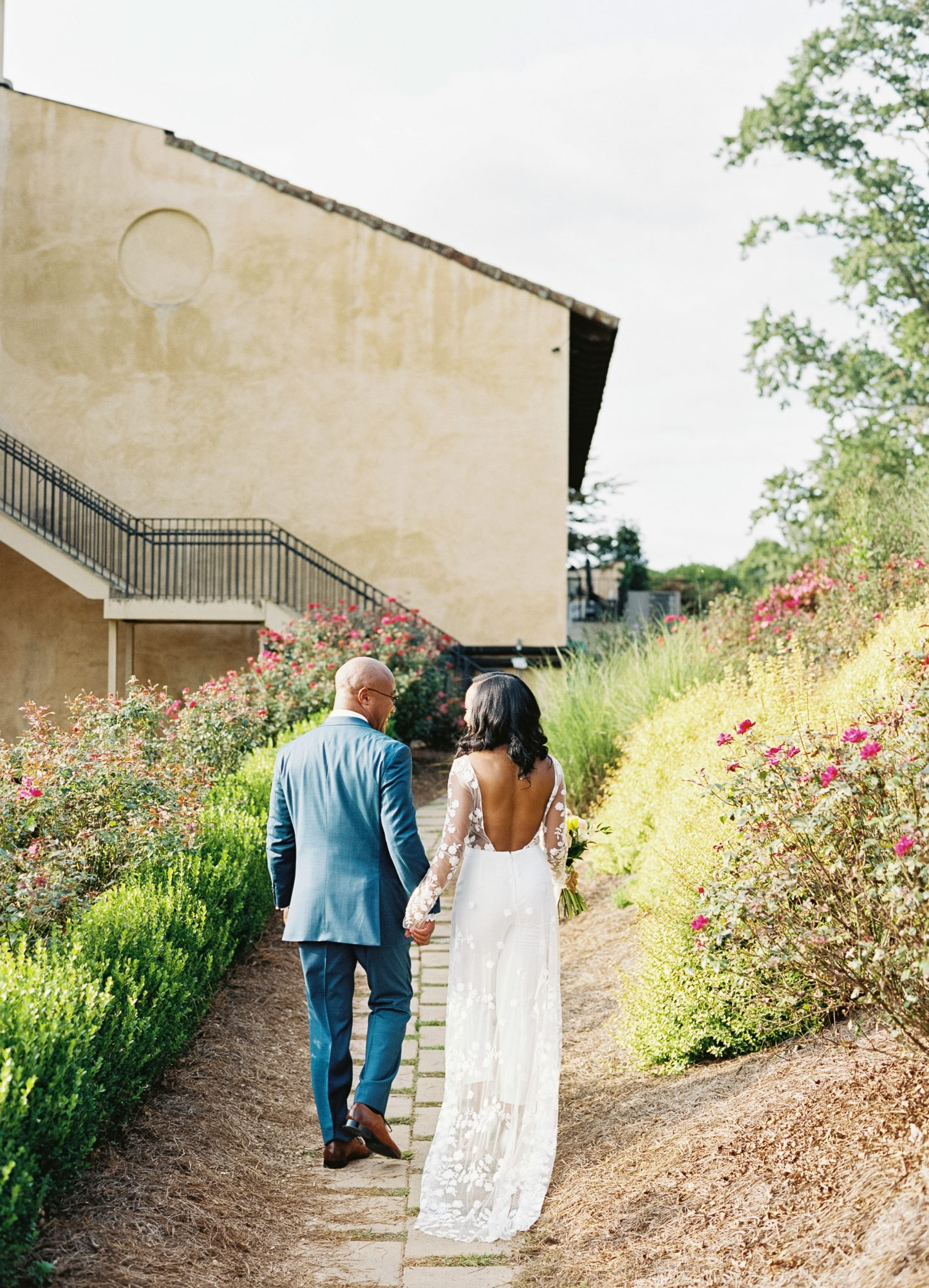 cayla david wedding couple holding hands and walking around the venue