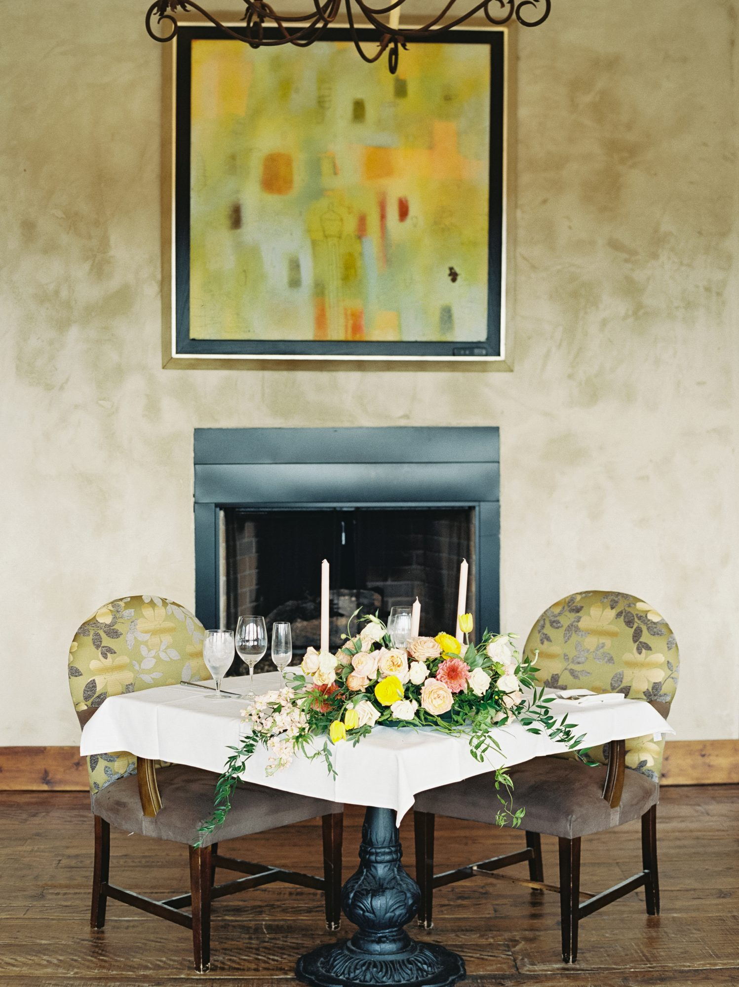 cayla david wedding reception table with colorful floral centerpiece