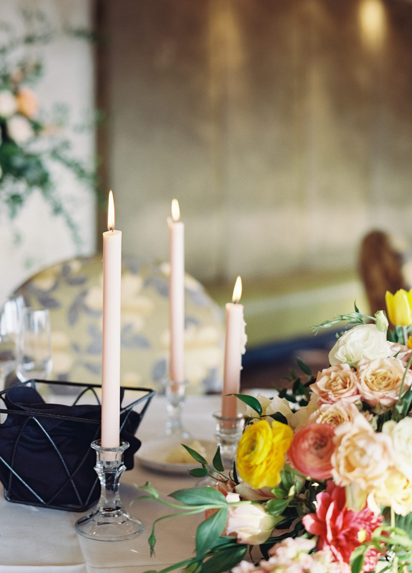 wedding tabletop with candles and flowers