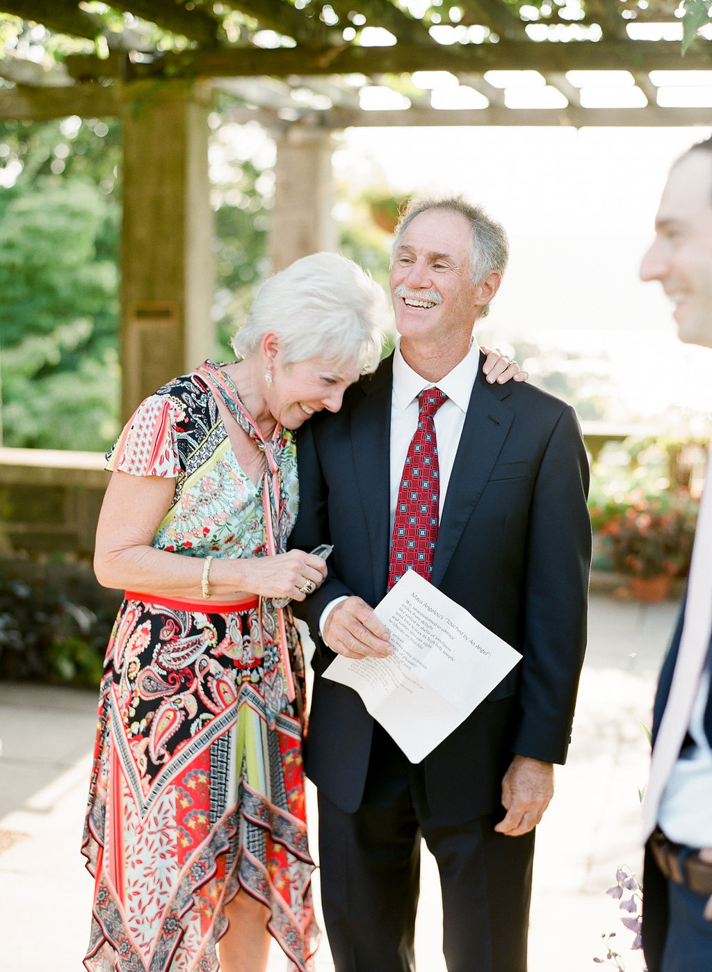 parents hugging and laughing during wedding