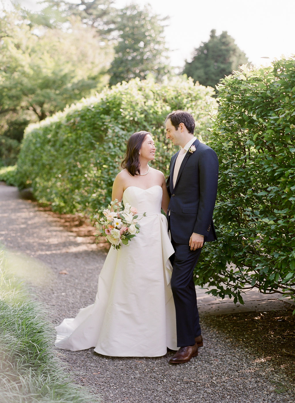 wedding couple portrait on garden path