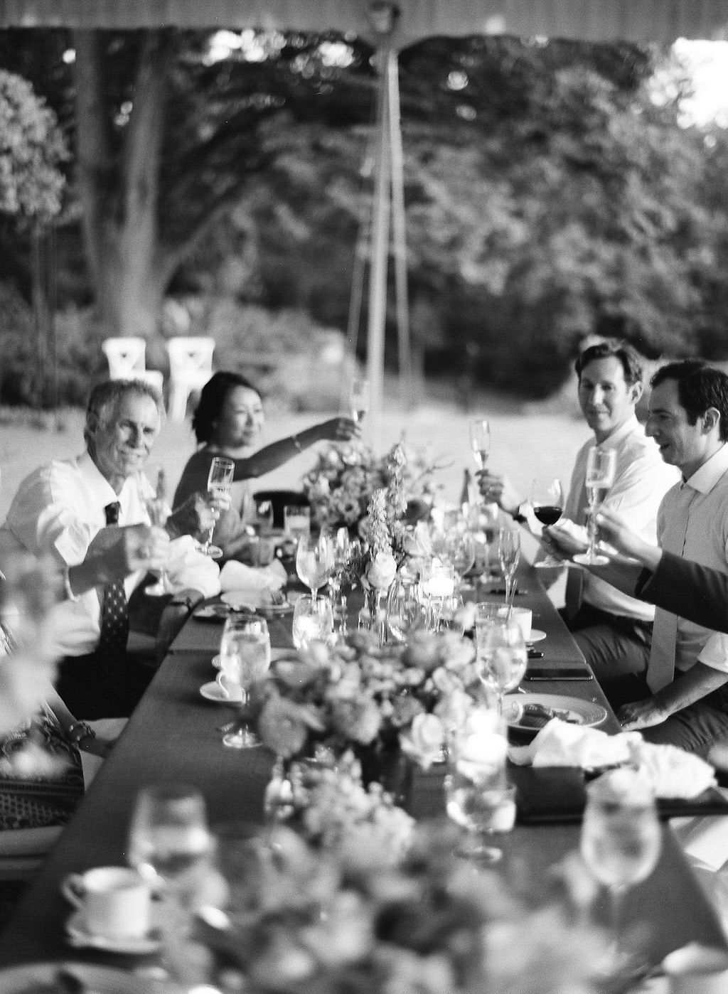 guest toasting during outdoor wedding tent reception
