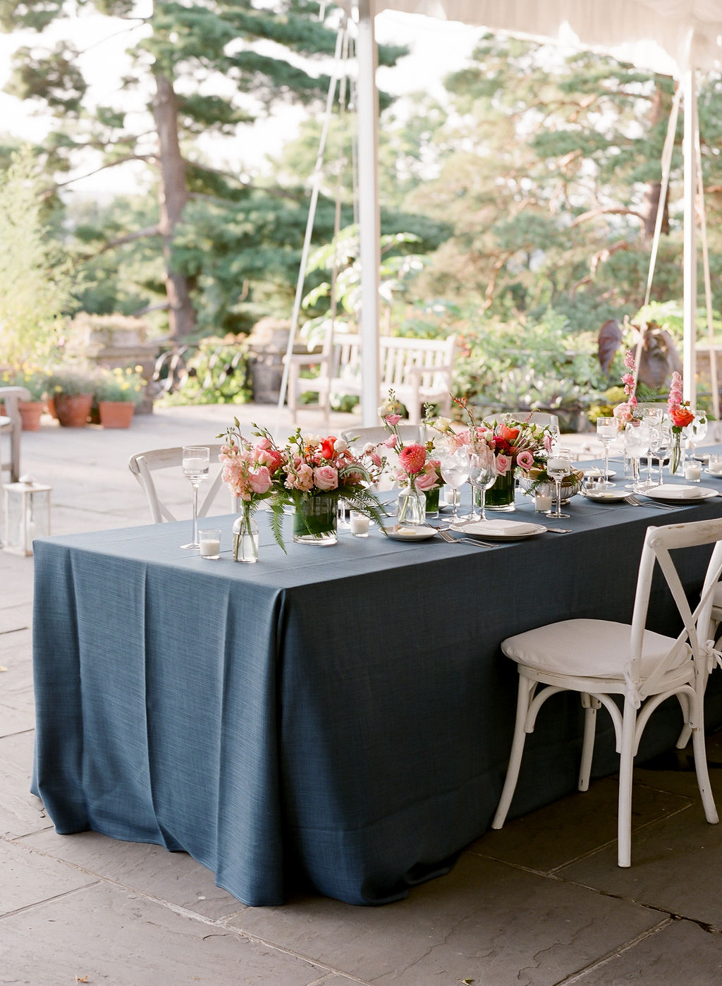long wedding reception blue table with pink flowers