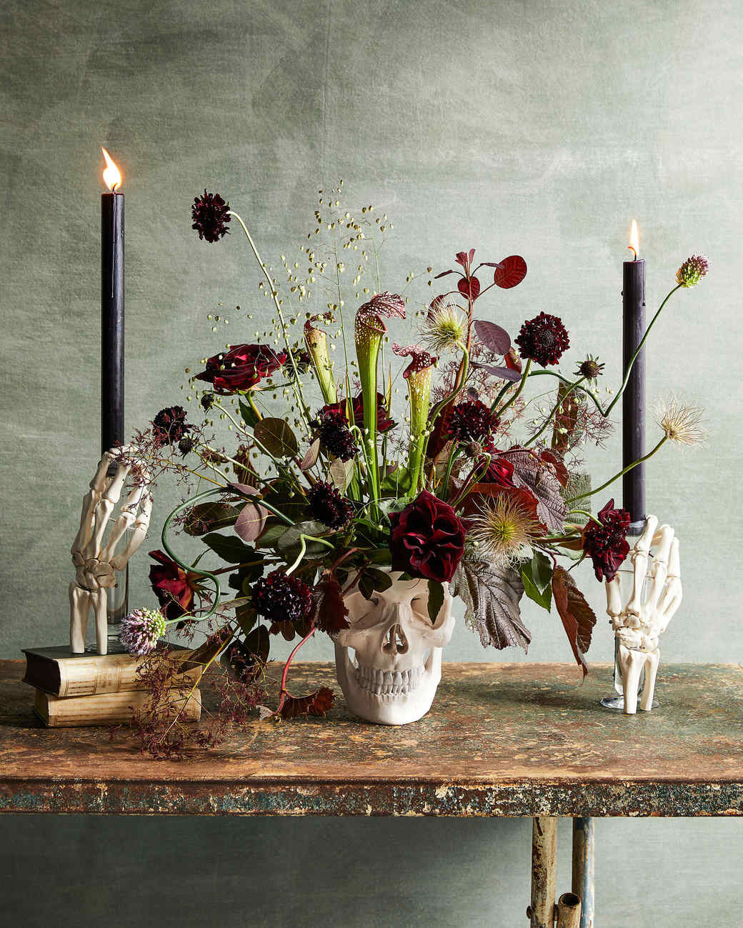 floral skull and skeleton hands centerpiece on table